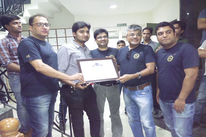 """Mr. Nishant Pitti receiving """"Certificate of Recognition"""" from Indigo team members"""